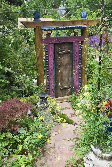An exotic colored gate creates an air of mystery at the entry of the backyard in Dan Johnsons Denver garden.