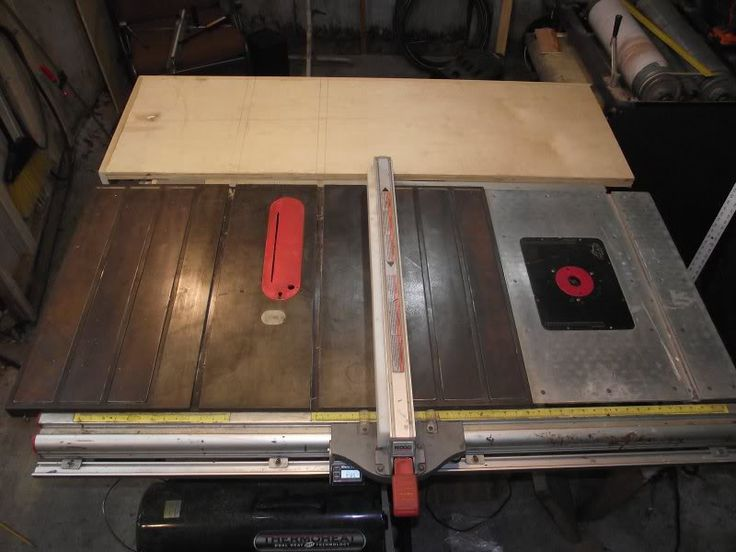 Table Saw Extension by drfixit -- Homemade table saw extension anchored directly into the sides of the saw. Steel extension supports were added, to which a plywood top was mounted. The open sides were covered with layered plywood (3x1/2) to create a solid working surface. http://www.homemadetools.net/homemade-table-saw-extension-2