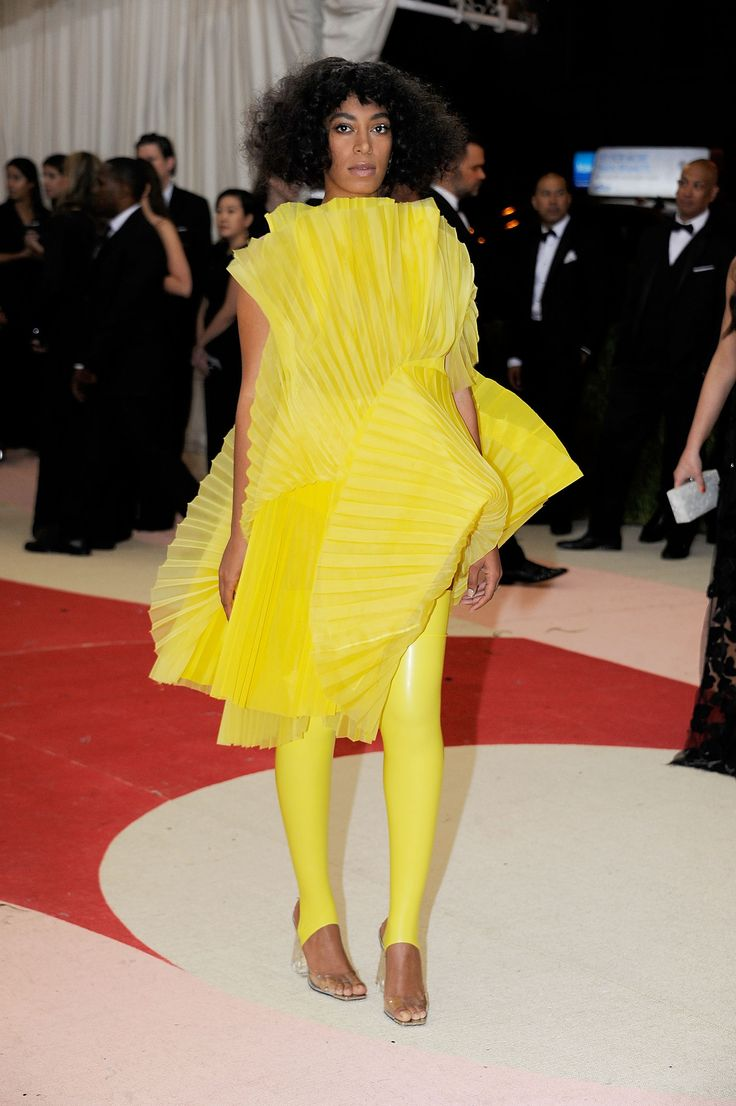Met Gala 2016: Solange Knowles Wearing a David LaPort latex outfit, Loewe heels, and an Edie Parker clutch.