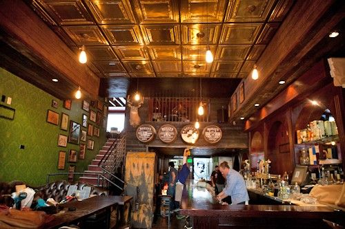 Rock & Reilly's Irish Pub, Los Angeles - I love the wallpaper contrast to the dark wood... and the frames up the stairs.