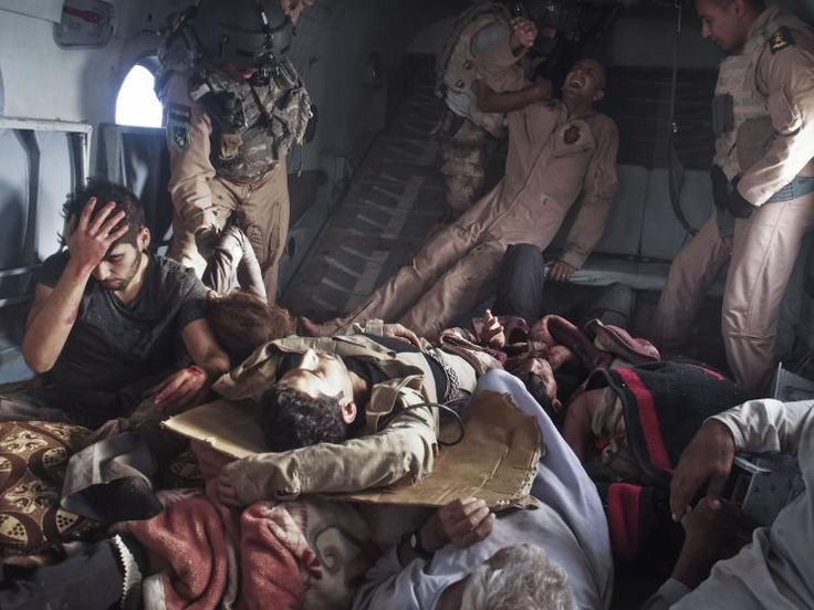 Injured survivors of an Iraqi Air Force helicopter crash in Mount Sinjar lie onboard a rescue helicopter on its way to Iraqi Kurdistan. The survivors included Yazidi civilians, Kurdish and Iraqi Army personnel, and journalists. Sinjar Mountains, Iraq, Aug. 12, 2014.
