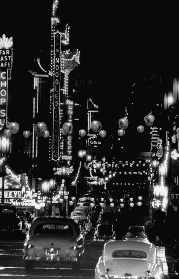 u201cCars driving through Chinatown at night San