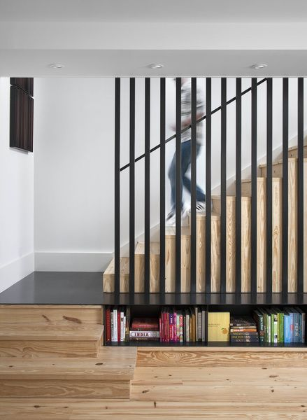 "The caged staircase was designed by architect Patrick Ousey, with whom Flournoy collaborated in the home's design. Although initially unconvinced by the staircase detail, ""it is a great example of how collaboration brings in different perspectives,"" says Flournoy. Courtesy of: Ryann Ford"