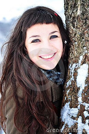 beautiful young woman smiling outside in winter time