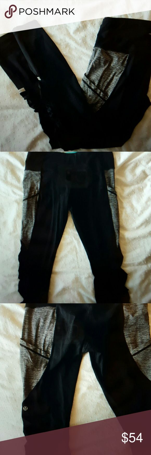 Lululemon running tights Only worn a couple of times.  Like new.  No signs of wear. High waist with zipper/pocket at back.  Full length. Two pockets on outer thighs on grey panels. Reflective detailing at mid calf. Made of lightweight luxtreme which is moisture wicking, breathable and has good compression.  Tag removed. Lululemon sz 10 is equivalent to a 12 in standard US sizing. lululemon athletica Pants Leggings
