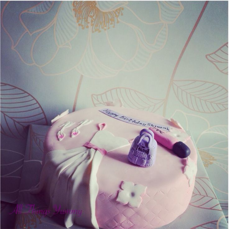 The second time around with this design with a tiny addition :) #dress #bag #shoes #heels #lipgloss #mac #aldo #handbag #girliecake #cake #chocolatecake #flowers #hydrangea #floral #edibleflowers #weddinggown #cinderellashoes #gumpasteflowers #macmakeup #cosmetics #girlie #whatagirlwants #atyummy #customisedcake #delhi #dessertgram #instacake