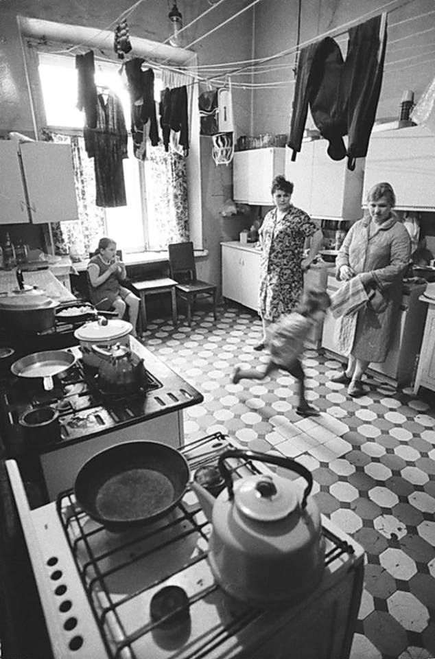 "Moscow Communal Apartment a.k.a. ""Kommunalka"" Soviet Russia - Moscow, 1983 communal apartment was shared between 2 to 7 families. Each one had its own room, which often served as a living room, dining room, and bedroom for the entire family. The hallways, ""communal kitchen"", bathroom and telephone (if any) were shared among all the residents. The communa was the predominant districts of large Russian cities."""