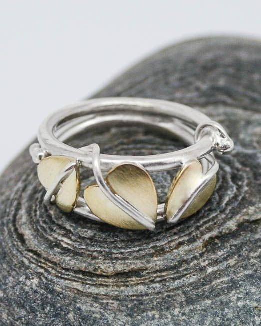 Completely handmade and original art nouveau styled leaf ring.  All leaves have been saw pierced from sheet brass then formed to shape with applied silver veins and stems.  The leaves have been given a matte finish with highly polished veins, which are mounted on a very comfortable double, round wire band.  We can also make this ring in all silver or mixed coloured gold. Please get in contact for an estimate.  #Floral #HandmadeJewellery #Leaf #MixedMetal #Ring #Silver #Starboard