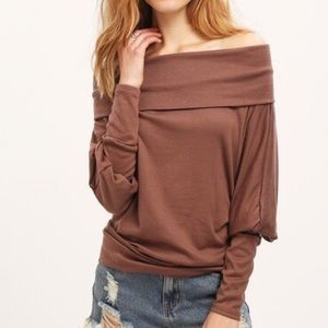 I just discovered this while shopping on Poshmark: Brown open shoulder batwing T shirt. Check it out! Price: $30 Size: Various, listed by lilyandco