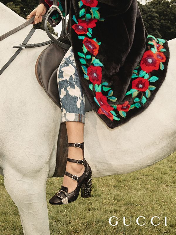 The multi-strap Queercore pump with embellished heels and the Dionysus buckle, worn with acid wash jeans in the Gucci Cruise 17 campaign. The Queercore line of shoes are named after a gay punk subculture of the 80s.