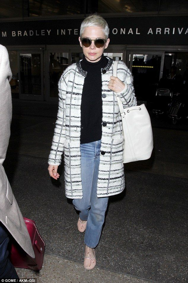 Back in the USA: Michelle Williams arrived in Los Angeles on Tuesday wearing a chic black ...
