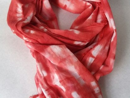 Woman's red shibori scarf