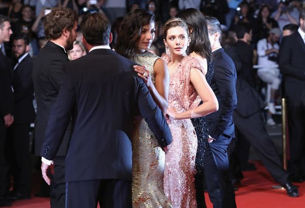 """(L-R) Jeremy Renner,  Director Taylor Sheridan, Nicole Sheridan, Elizabeth Olsen and Julia Jones attend the """"The Square"""" screening during the 70th annual Cannes Film Festival at Palais des Festivals on May 20, 2017 in Cannes, France."""