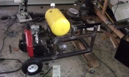 Portable Welder - Homemade portable welder constructed from steel. Powered by an 18 HP engine and equipped with a 130A alternator.
