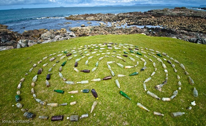 Improvised Labyrinth-A labyrinth made of bottles found on the coast of Iona at the crumbling edge of a former dump hidden below the surface of the grassy bluffs. from + Biomorphic Org + labyrinths, sacred geometry and organic architecture Facebook Page
