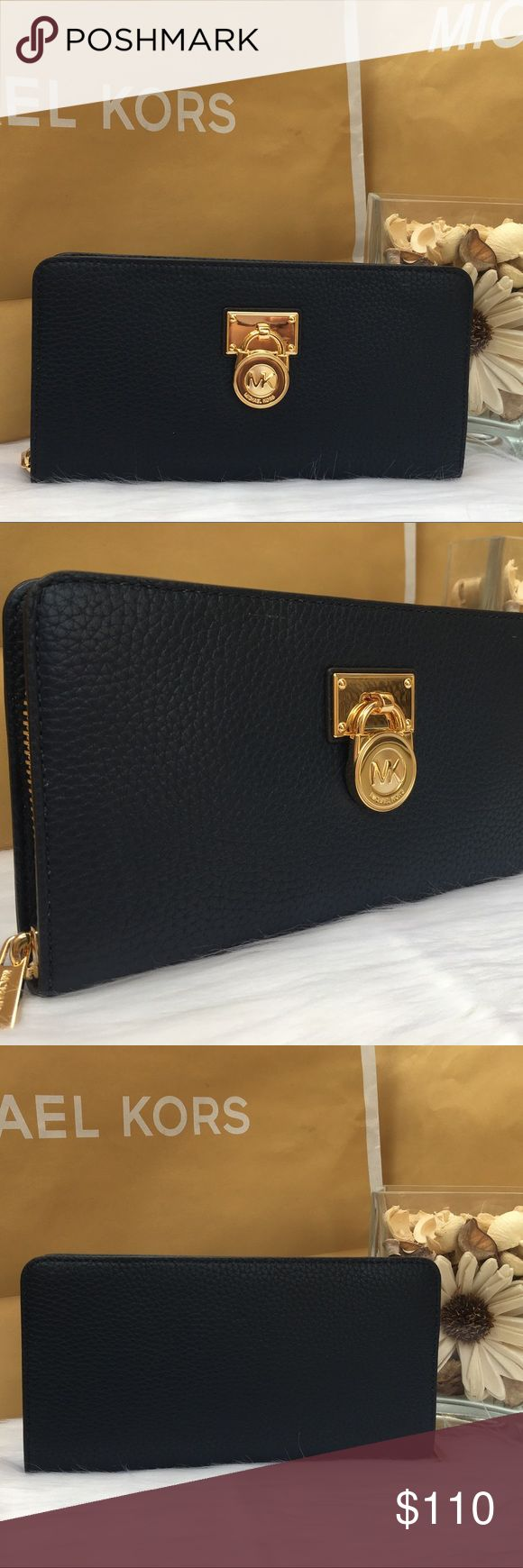 """NWT Michael Kors Hamilton Zip Around Large Wallet ❤️PRICE FIRM❤️ Brand New with Tag! 100% Authentic  MK Michael Kors Hamilton Traveler Wallet Large Zip Around Navy Blue Luggage Wallet Made of logo MK PVC with leather trim and LOCK detail on front Style:35F6GHXZ3L •Retail price $148  •Zip around for closure •Inside features 12 credit card slots. •3 full length bill compartments •Full leather & Signature fabric lining •Gold hardware Dimensions :8.10""""(L) x 4.35""""(H) x 1""""(D)  Check out my closet…"""