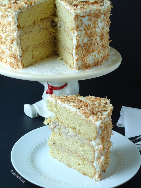 coconut cream cake with coconut almond pastry cream filling and coconut cream cheese frosting