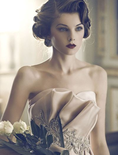 Gorgeous hair, dress, and make-up. I love how the hairstyle reflects the ruffles in the dress.