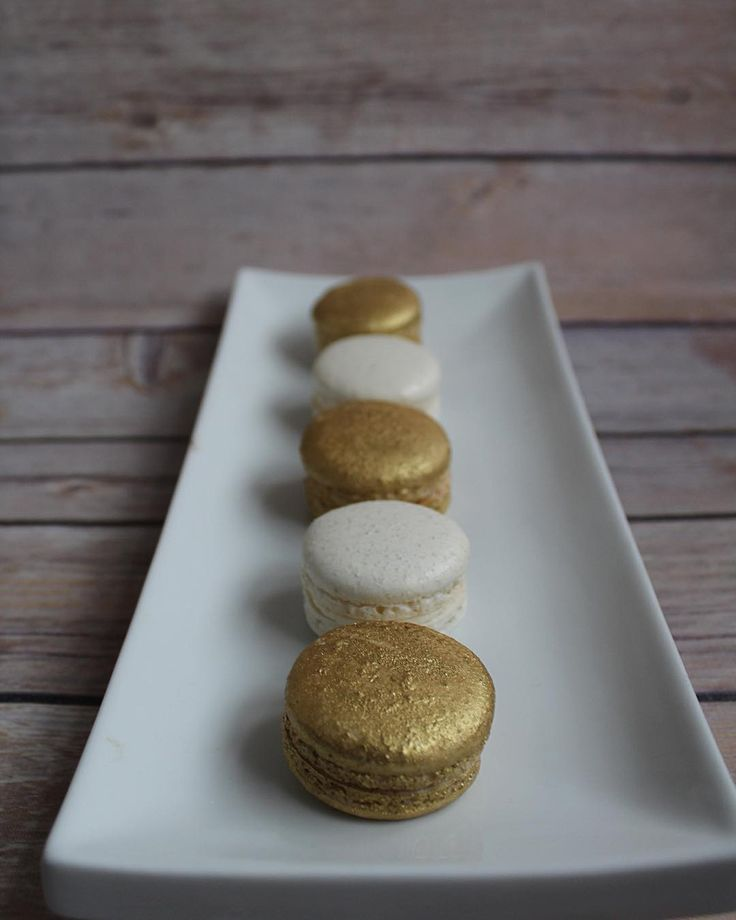 Today's post is part of a bigger picture but I love the #gold #macarons! #frenchmacarons #goldmacarons #mississaugamacarons #vanilla #almond #sweettable #mississaugabakery #mississauga #gtabakery #gtacakes #toronto #torontobakery #portcredit #portcreditbakery #torontocakes #delicious #foodporn #cakeporn #edibleart #sassyandsweet