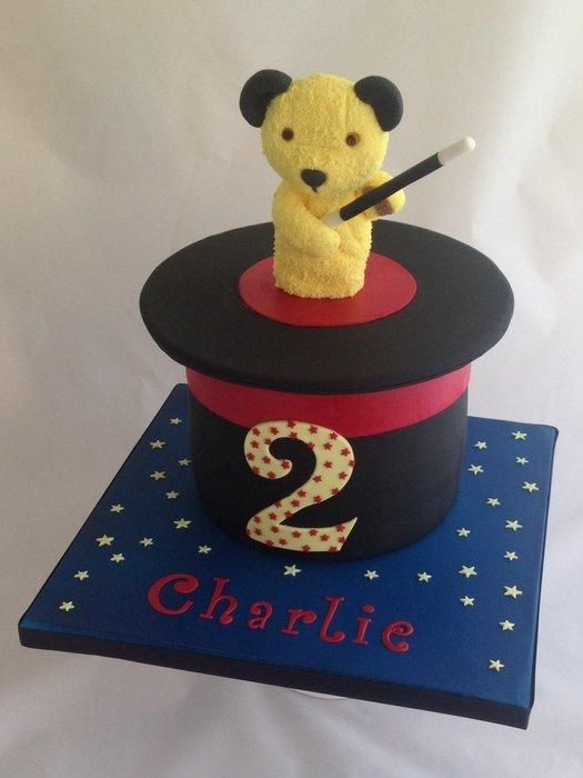 This cake was for a little boy who loves Sooty! The cake is three layers of vanilla sponge filled with raspberry jam and buttercream and covered in fondant . The tricky part was working out how to do the rim of the hat itself! In the end I covered...