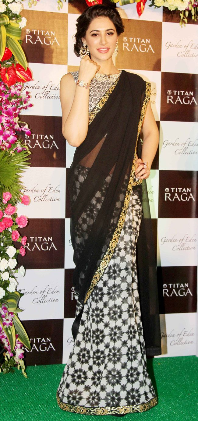 Nargis Fakhri in a stunning black saree by SVA at a Titan Raga event. #Bollywood #Fashion #Style #Saree