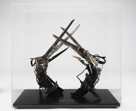 """The prop 'scissorhand' gloves that Johnny Depp wore in Tim Burton's """"Edward Scissorhands."""""""