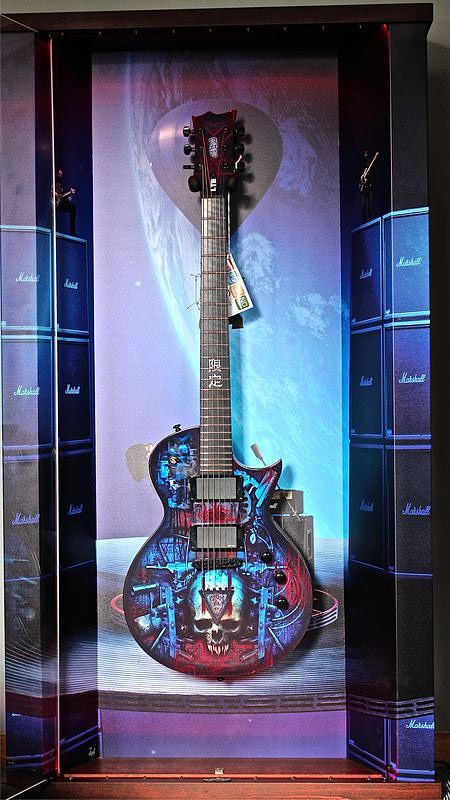 "Wall guitar display ""Concert For The Aliens"" and LTD Special"