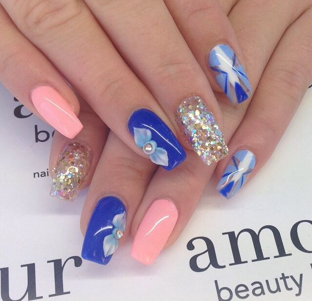 Beautiful blue and coral gel nails with sparkle