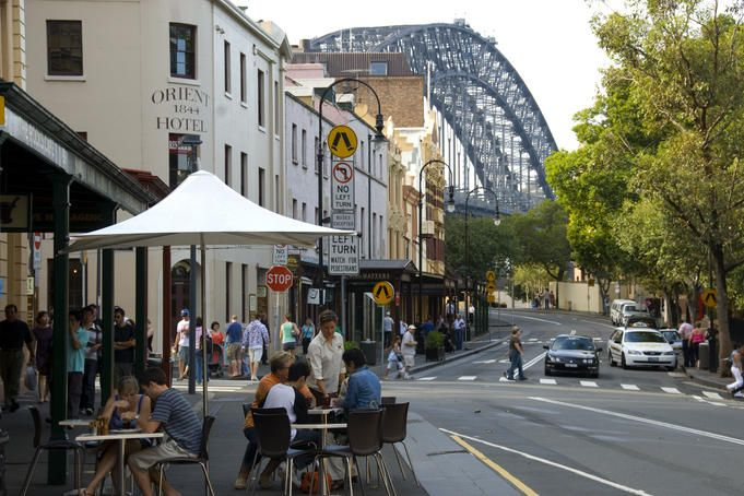 Harbour Bridge, Sydney  Outdoor dining at The Rocks Cafe, 99 George Street, The Rocks, with Sydney Harbour Bridge in background.