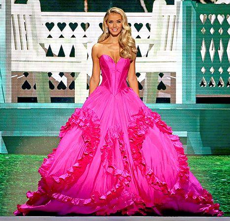 Miss Oklahoma, Olivia Jordan, poses in a bright pink gown during the Miss USA pageant.