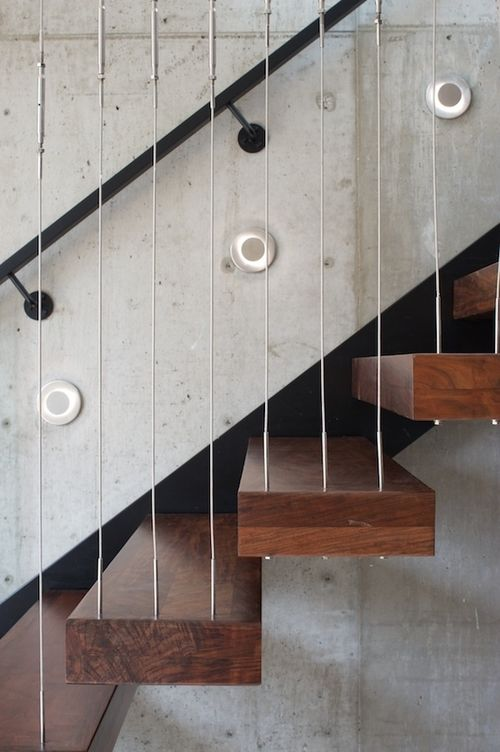 Arc House -Walnut, steel concrete staircase