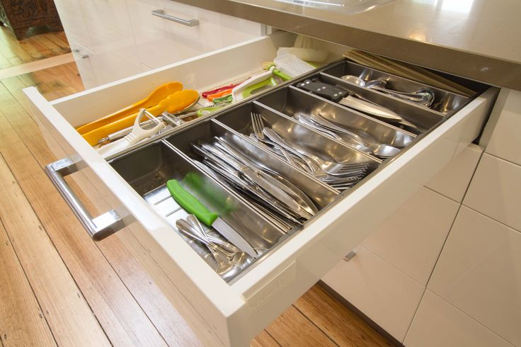 Modern contemporary kitchen with gloss 2pac finishes. Adjustable cutlery drawer. www.thekitchendesigncentre.com.au @thekitchen_designcentre