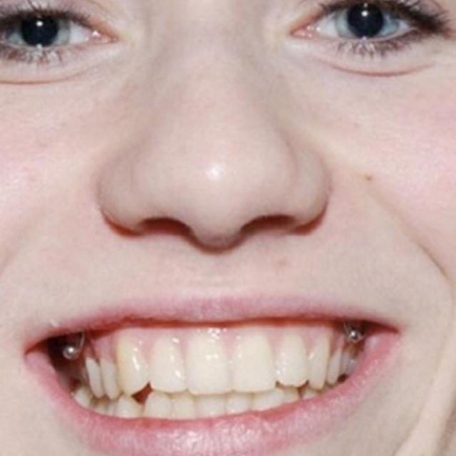 Piercing your gums is a REALLY bad idea. I think it is so cute, but that is not good to keep against your teeth all day.