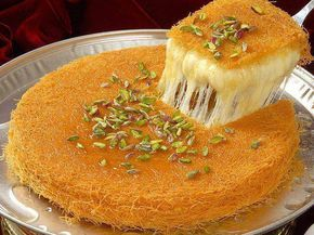Kaymakli künefe – Turkish dessert with Arabic orgins. It is made of a sweet, very fine vermicelli-like pastry and stuffed with cheese. This is cooked in small copper plates, and then served very hot, in syrup, with clotted cream (kaymak), and pistachios or walnuts.
