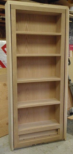 Interior access from garage to downstairs living room (hidden bookshelf door)