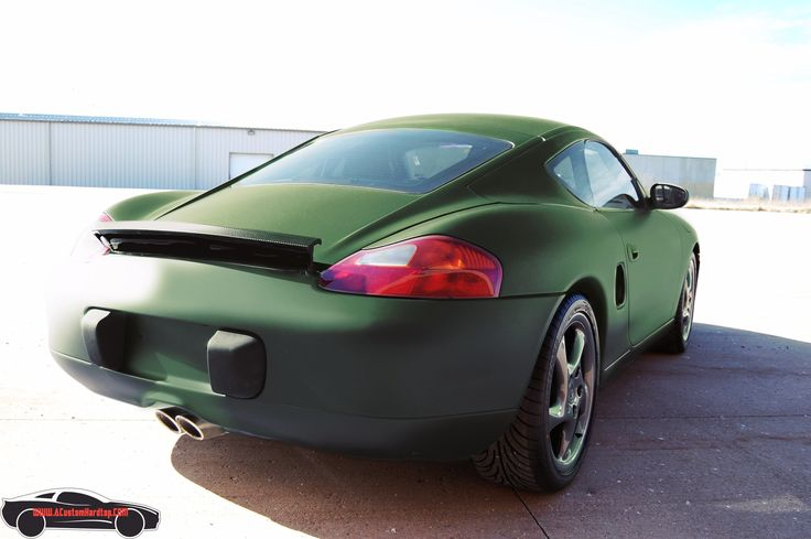 Olive green porsche boxster with installed hardtop upgrade.