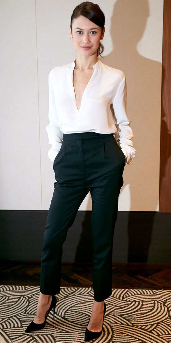 Chic, elegant style! Olga Kurylenko looked great in this black and white ensemble, pairing a white blouse with high-waisted trousers and stiletto heels.