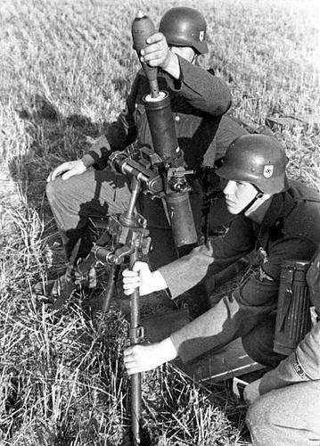 SS soldiers preparing to open fire from an 81-mm mortar (8 cm Granatewerfer 34) during the invasion of Poland.