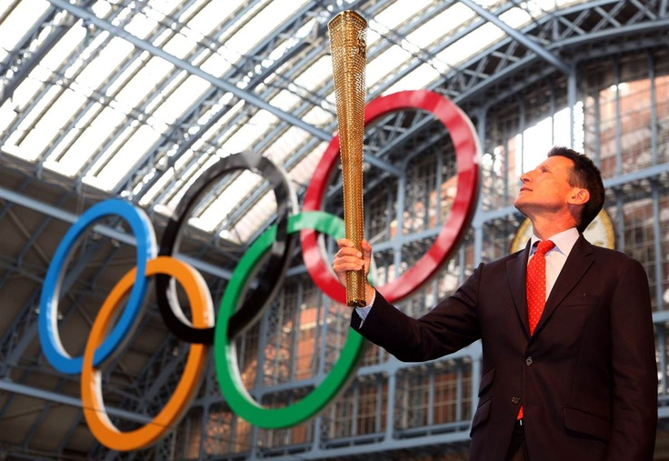 Torch unveiled    Sebastian Coe, chairman of the London 2012 Olympic Organising Committee, poses for pictures with the newly unveiled 2012 London Olympic Torch on June 8 in London. Runners will use the torch to carry the Olympic flame 8,000 miles around Britain to the opening ceremony.