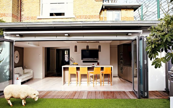 Putney house kitchen - a fantastic example of how a single storey extension can look robust, modern and stylish rather than a crappy old lean-to or extension constructed with corrugated iron roof! Extend outwards and bring your outdoor in with bi-fold or concertina glass doors to open up the whole length of the room. Summertime, open up to use with the outdoor space. Velux windows or roof lights will bring more light into the space.