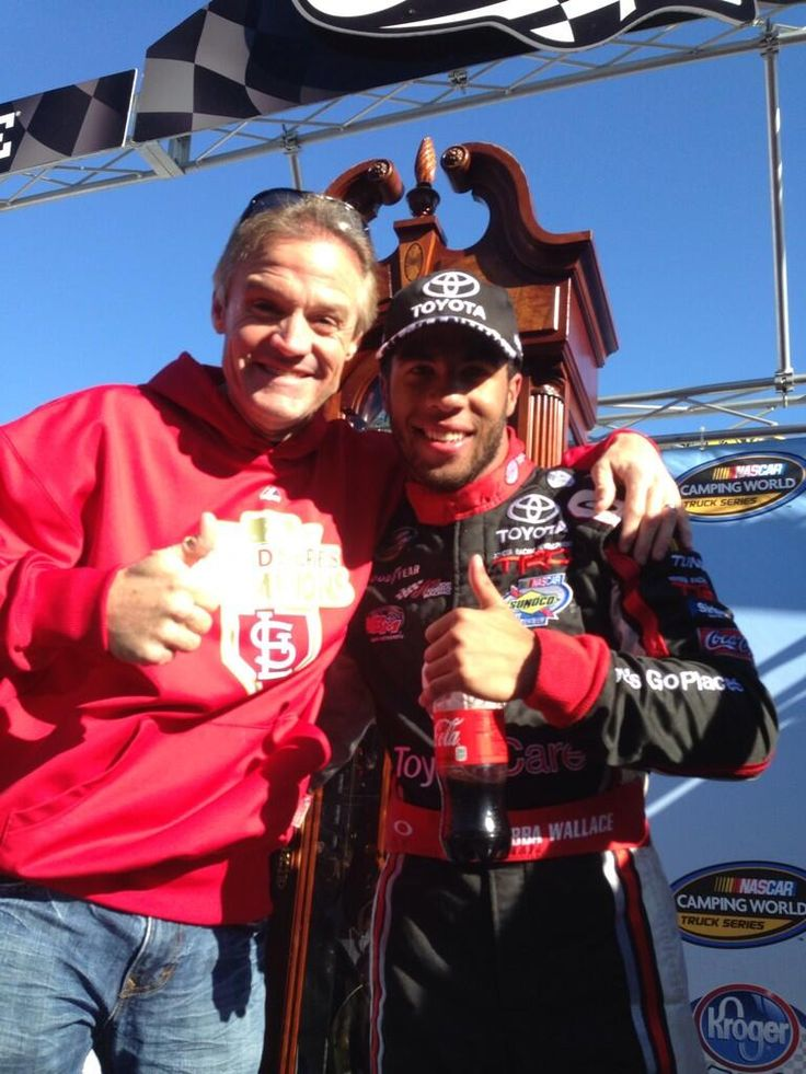 "Kenny Wallace and Darrell ""Bubba"" Wallace Jr. in front of Bubba's Martinsville trophy, 10/12/13.  Kenny Wallace (Kenny_Wallace) on Twitter"