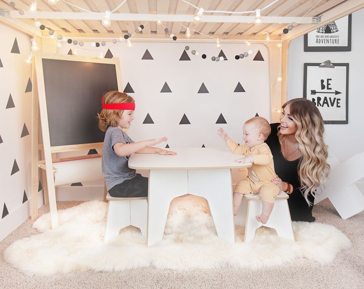 We love this whimsical play space under this loft bed in a big kid room - the black and white create such a hip, mod space! #blackandwhite #pishposhbaby