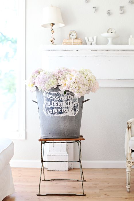 I just recently learned that if you slightly smash the ends of the hydrangeas and add ice to your water,  your cut hydrangeas should last longer...