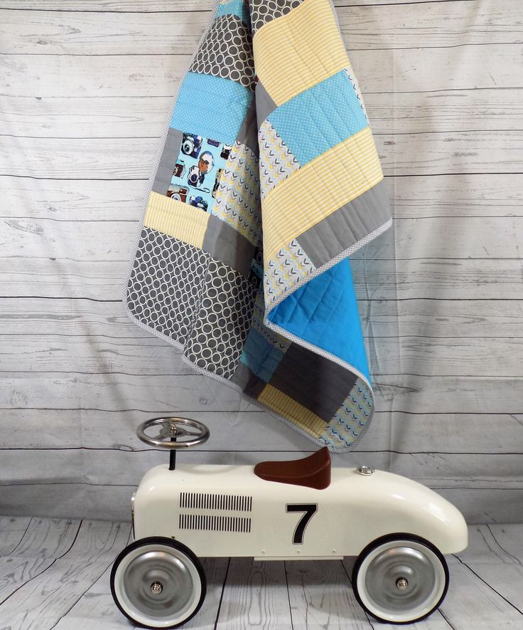 A personal favourite from my Etsy shop https://www.etsy.com/uk/listing/232987829/modern-baby-quilt-retro-baby-quilt-retro