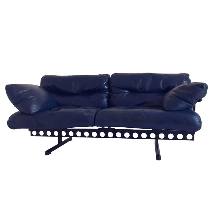 1982    This lounge sofa featuring a sturdy perforated steel frame and leather vintage cushions was designed by Pierluigi Cerri for Poltrona Frau in 1982. Marked multiple times.