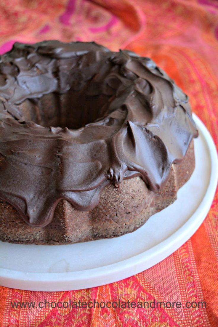 Tunnel of Fudge Cake is a brownie-like bundt cake with a tunnel of chocolate cheesecake filling. The dark chocolate ganache is thick like frosting and adds a nice finish. Make this with @sbchocolate for a real treat!