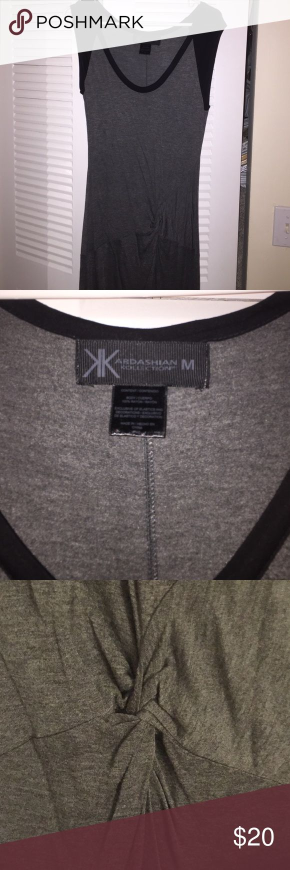 Kardashian Kollection women's gray midi dress M Kardashian Kollection women's gray short sleeve colorblock dress. Knotted center. Midi length. Women's sz M. Brand new, never worn without original tags. Fast shipping!  Kardashian Kollection Dresses Midi