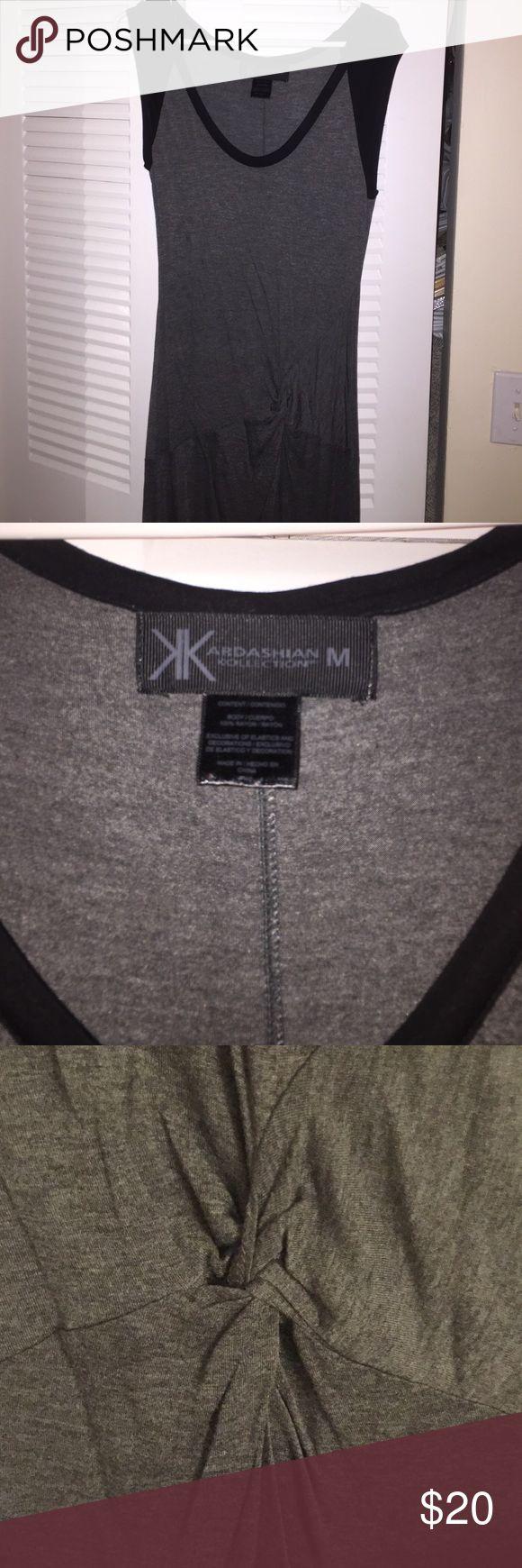 Kardashian Kollection women's gray midi dress M Kardashian Kollection women's gray short sleeve colorblock dress. Knotted center. Midi length. Women's sz M. Brand new, never worn without original tags. Fast shipping!  Kardashian Kollection Dresses Midi
