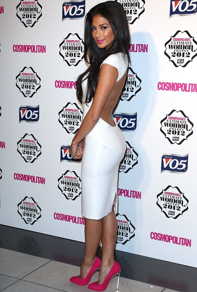 Nicole in a white backless dress with fuchsia lips and heels at