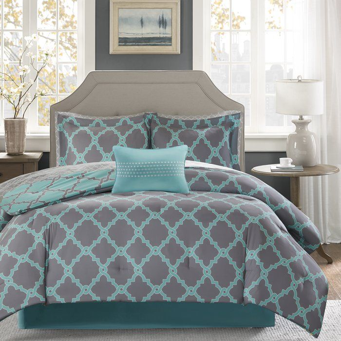 The Latitude Run Winard comforter set creates a simple yet chic look in your space. The fretwork design creates a modern look with its design on a bold base. This set is completely reversible to a base with geometric design allowing you to change the feel of your room instantly. A 180 thread count printed sheet set also features a smaller scale fretwork pattern for a finished look.